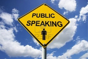 11589704-public-speaking-sign-against-a-cloudy-background